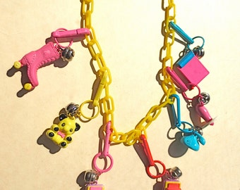 Plastic Bell Clip Charm Necklace  -   Funky Bell Bling - Collectible Girly Pop Culture Color - 7 Charms Yellow Link Chain Fashion Jewelry