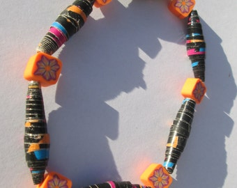 black and orange paper beads and polymer clay beads stretch bracelet in bright shades affordable unique by Ziporgiabella