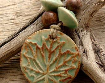 MAPLE LEAF - Green with hints of Chocolate Brown Pendant with two top shaped beads and two Round Beads - Handmade Ceramic Pendant Set