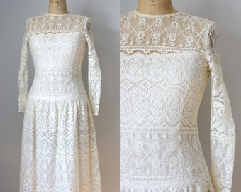 vintage bridal wedding gown. Talbots. mid 1990s. lace. off white cream. drop waist. tea length. scalloped hem. long sleeve.
