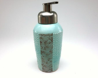 Light tomato red glazed porcelain foam soap dispenser with dots and swirl pattern and brushed nickel pump