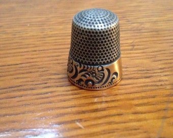 Silver and gold vintage thimble