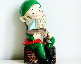 Vintage Homco Elf - carving a ship - on a log - ceramic