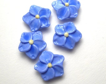 handmade artisan lampwork Forget Me Not Beads in light periwinkle blue and bright yellow