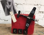 Fly picture holder with reclaimed materials and old metal airplane by Old Barn Rescue Company