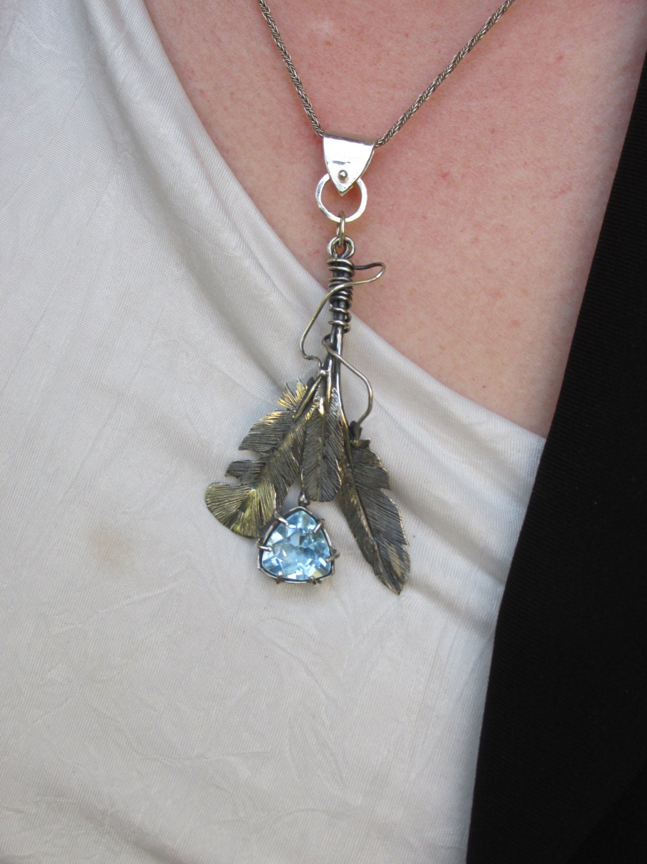 sterling silver sky blue topaz brutalist feather pendant