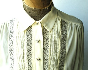 Boho vintage 60s off white nylon blouse with clear rhinestones buttons and lace. Made by Carol Henry. Size Large.