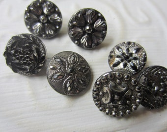 Vintage Buttons - lot of 7 jet black,  silver luster pressed assorted designs Victorian, 1/2 inch (lot sept 320)