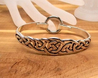 Sterling Silver Celtic Motif Slave Cuff With Stainless Steel Captive segment Ring Clasp