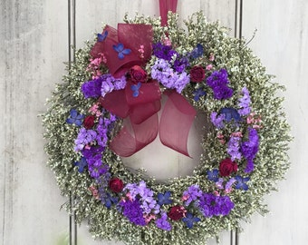 romantic dried flower wreath with babies breath and red roses. This is made and ready to ship.