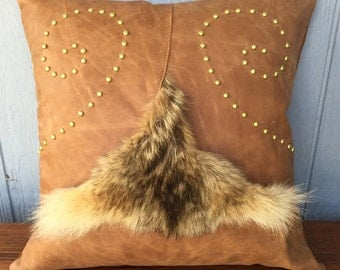 Coyote fur and leather pillow with swirl studs