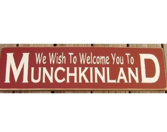 We wish to welcome you to Munchkinland primitive sign