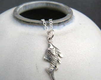 tiny sterling silver fish necklace. small ocean pendant. animal nature sea aquatic marine. simple delicate everyday jewelry. good luck charm