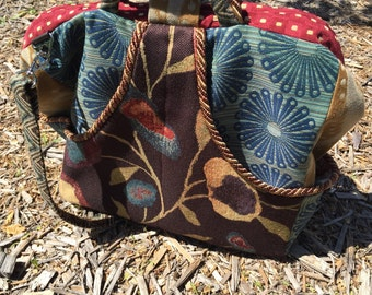 Curved Double Pocket Big Carpet Bag with mix of tapestry patterns in dark brown, burgundy, tan and teal blue