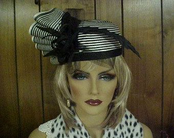 """SALE.   Black and white pill box hat with fan like side adornment- fits 21"""" -or small"""