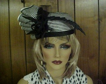 "Black and white pill box hat with fan like side adornment- fits 21"" -or small"