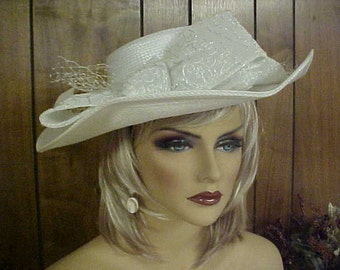 white hat with wide wavy brim- decorated with ribbon and silver thread- fits 21-22 ""