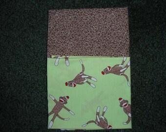2 Yards of Assorted fabrics  by Moda    Sock Monkey Fabrics
