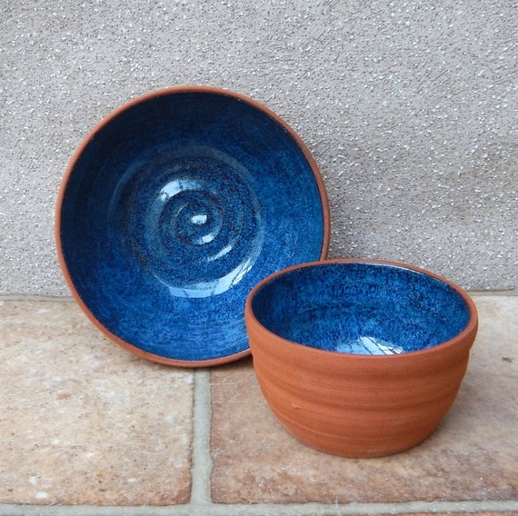 Pair of nesting serving bowls hand thrown in terracotta pottery ceramic