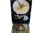 FREE SHIPPING! Hard Drive Clock Accented with Former Cover as the Base Accented with Golden Disk Spindle.
