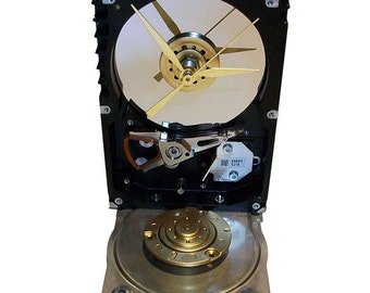 FREE SHIPPING USA! Hard Drive Clock Accented with Former Cover as the Base Accented with Golden Disk Spindle.