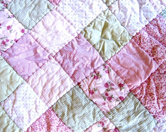 Vintage Baby blanket with many shades of pink and a nice light green