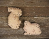 hand-stitched wool felt wall art: two rabbits by kata golda