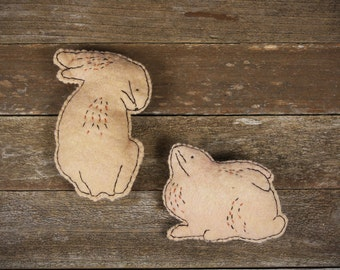 hand-stitched wool felt wall art: two rabbits by kata golda