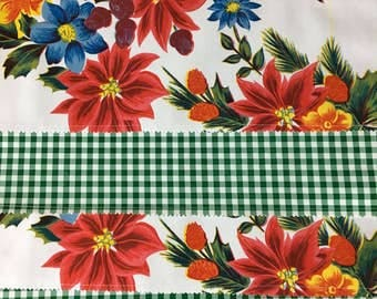 Reversible Christmas oilcloth placemats in a poinsettia pattern