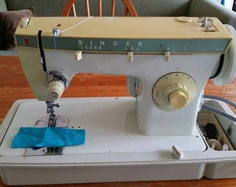 1972 Singer model 242 sewing machine complete with original user guide