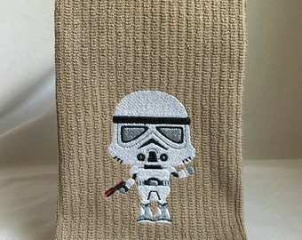 Young stormtrooper embroidered on brown vertical bar towel