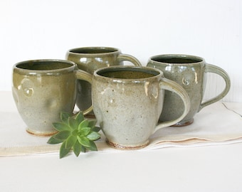 Set of four stoneware mugs. Coffee cup, tea cup, rustic, altered, earthy, gray, golden, celadon, mossy, speckled,