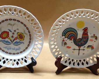 Two PA Dutch Plates Var Sa God with Flowers and One with Rooster Open Weave Edge