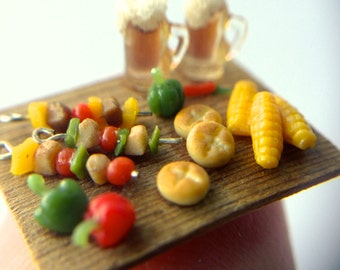Quarter scale kebabs, corn cobs and beer