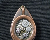 Steampunk style pendant. Brass, copper, glass and watch parts. Fully waterproof.