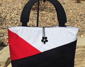Black Suede Red Cotton White Eyelet Lace Color Block Over the Shoulder Purse.  Wooden handled top handle purse. Colorblocked handbag