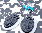 Black and White Anatomical Heart Earrings with Blue Bow