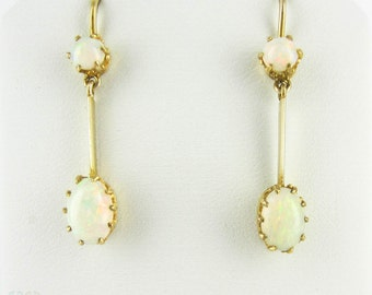 Antique Opal Dangle Earrings, Double Oval Cabochon Cut Opal. Circa 1900s, 9 Carat Yellow Gold.