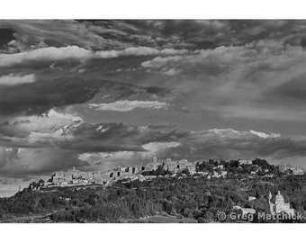 Fine Art Black & White Landscape Photography of a Dramatic Sky and Clouds Over the Tuscan Hilltown of Montepulciano