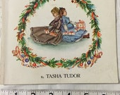 The Doll's Christmas Tasha Tudor illustrations Dolls playtime paperback cover, small book good vintage condition 28 pages
