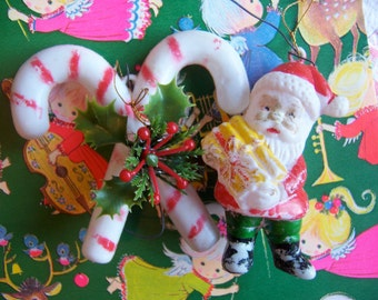 little plastic santa and candy cane ornaments