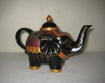 Vintage elephant teapot in black with gold and multiclors