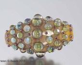 Bumpy, Lampwork Bicone Bead in ivory, green, metallic pink and beige by Helen Gorick