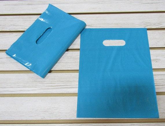 100 Teal Plastic Merchandise Bags (9 x 12 in.)