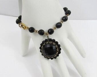 """Black Faceted Glass Bracelet - 6.75"""" Linked bracelet with 1"""" domed dangle - 50s-60s"""