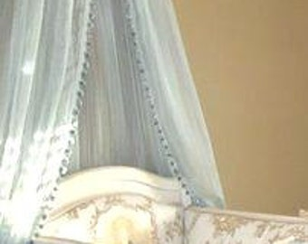 Blue Sheer Bed Canopy with pom pom trim