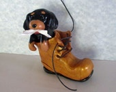 SPECIAL ORDER for PAMELA Adorable Playful Cavalier Charles Spaniel puppy, black and tan, in laced work boot