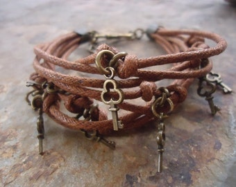 Nine BRONZE KEYS - strap bracelet  with hook closure (793)