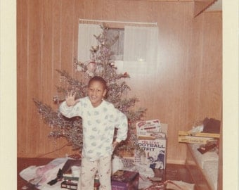 1960's Young African American boy with Christmas toys vintage children photo.