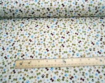 Pet Rescue Dogbones and Pawprints  Toss on Cream premium cotton fabric from Leanne Anderson for Henry Glass and Co